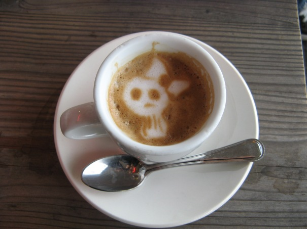skull with a bow latte art.